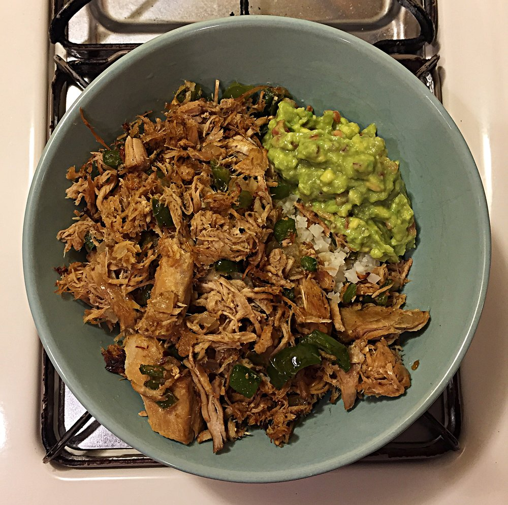 Carnitas with green bell pepper, onions, served on a bed of riced cauliflower and homemade guac!