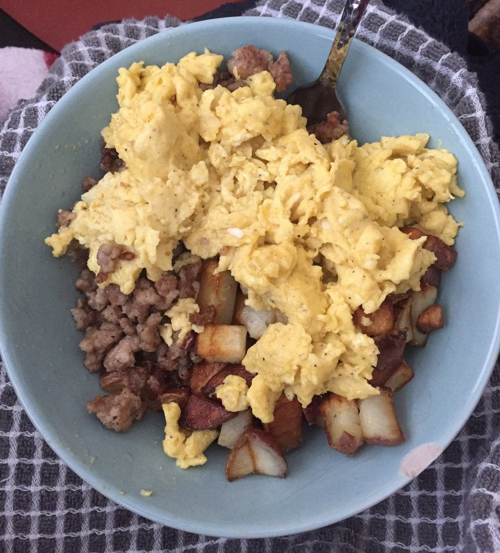 Breakfast bowl variation: Potatoes, ground pork, topped with scrambled eggs!