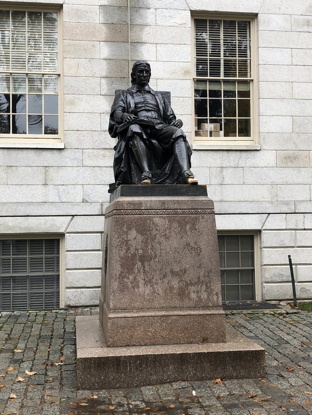 John Harvard. Apparently it's good luck to rub his toes.