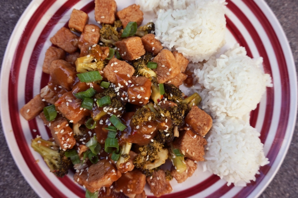 Vegan general tso's chicken with broccoli and rice.