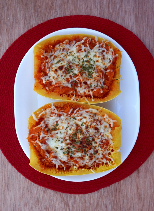 Baked spaghetti squash with marinara, vegan mozzarella, and parsley.