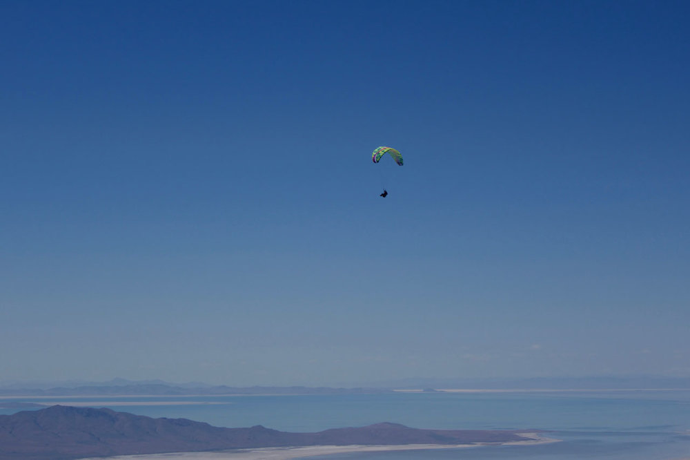 """Calef soaring above the """"V"""" launch with the Great Salt Lake in the distance, photo Ryan Dunn."""