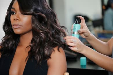 - STEP 5After forming curls throughout the hair, use your fingers and Shine Spray to separate the curls and to give definition, shine and a worn in look.