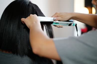- STEP 3Using a ceramic flat iron, take 1/4 inch sections and spray with Heat Protection Spray. Starting near the scalp without touching it, gently glide down the hair strand in a fluid motion. Repeat if necessary on the section. Continue through entire head.