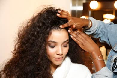 - STEP 5Use a finger diffuser to dry the hair, being careful to not overwork which causes frizz.