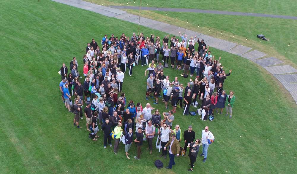 The Boffa MIskell team celebrates by forming a koru at the company's 45th anniversary event.