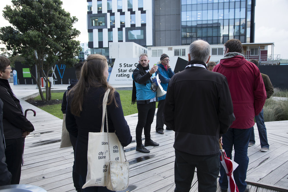 Henry Crothers (LandLAB) talks to delegates on the walking tour of Wynyard Quarter.