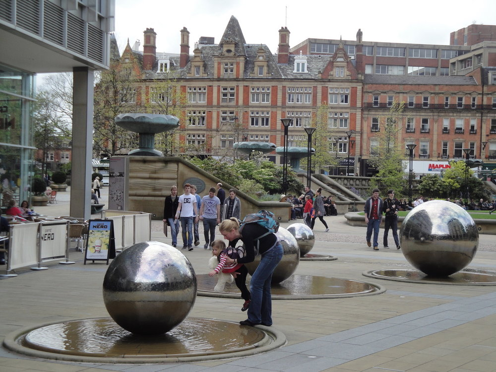 The delight and curiosity of interacting with water in Sheffield, a city with an integrated urban water plan.  Photo credit: Jenny Roe.