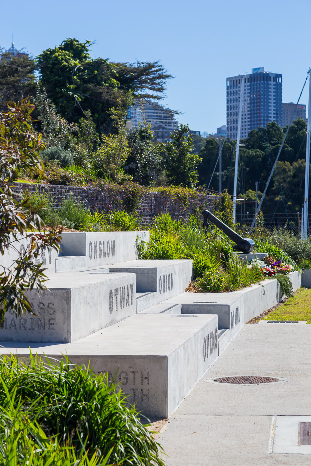 Urban&Public designed the subtle yet integrated marker and memorial to the submariners and six submarines which were based at the site.  The site also once housed a torpedo manufacturing and maintenance factory.  Photo credit: Urban&Public.