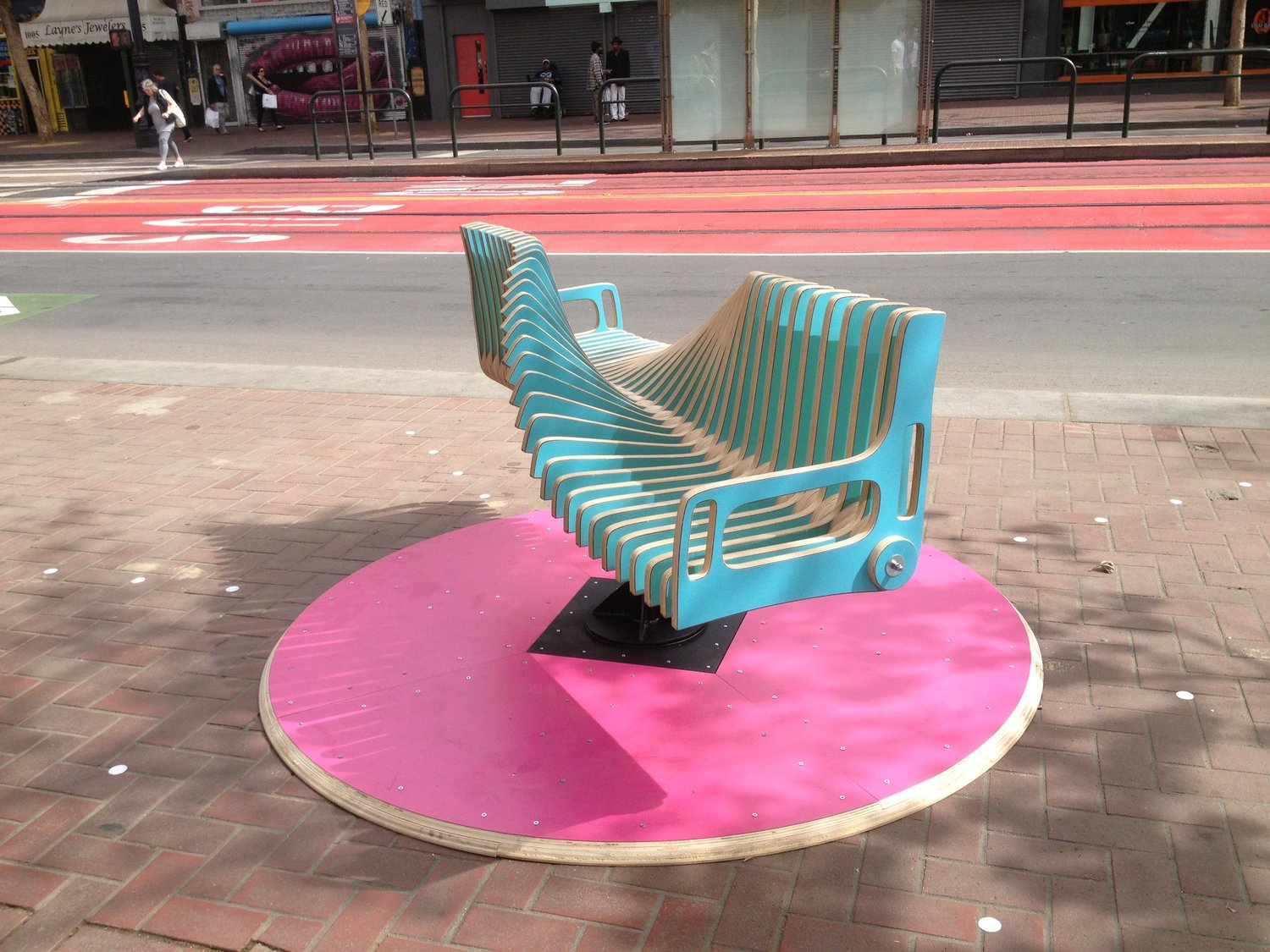 The Bench Go Round playfully re-imagines public seating to create connection between strangers. It's the creation of George Zisiadis and Rachel McConnell in San Francisco. Photo credit - George Zisiadis.