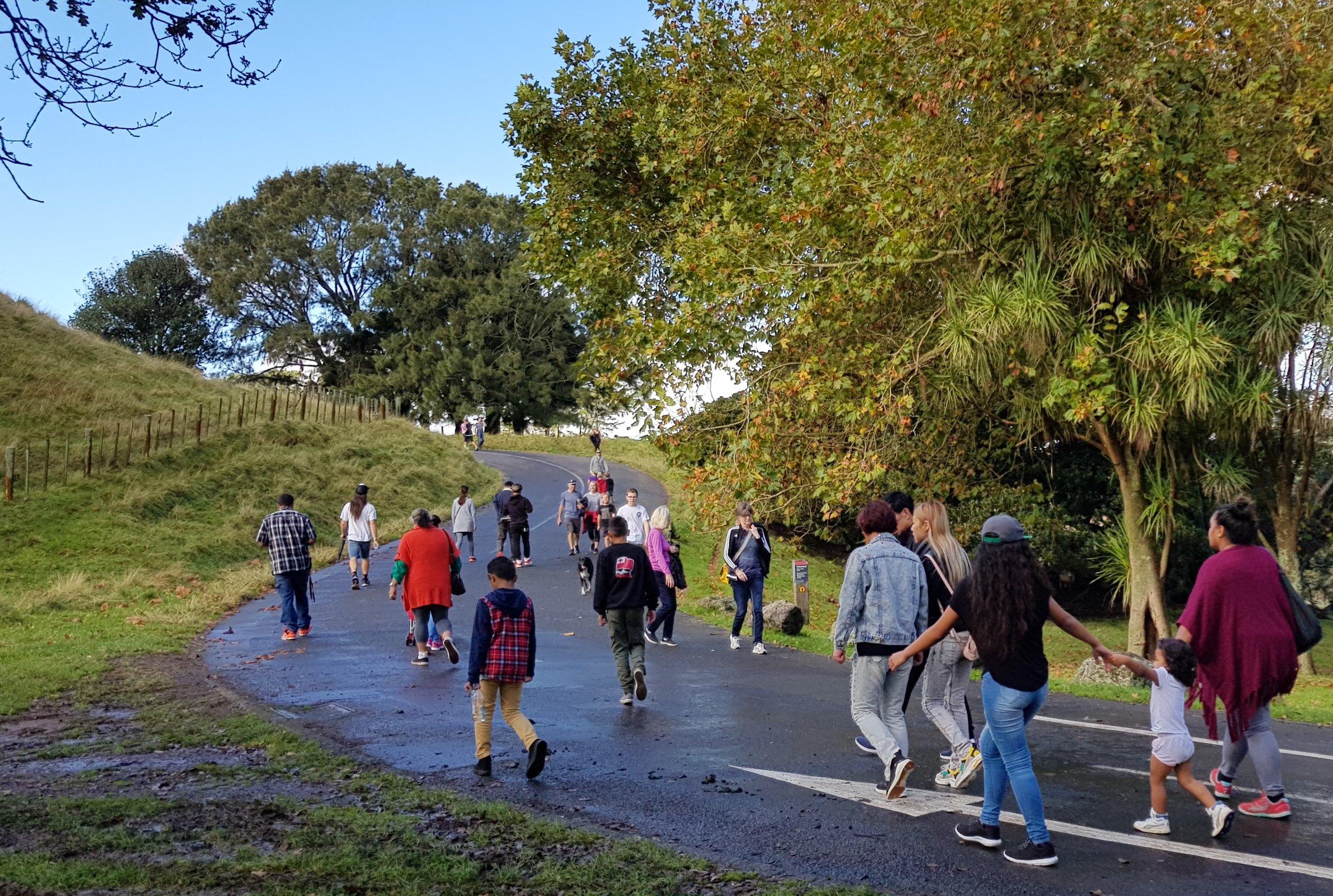 Visitors enjoy the newly-pedestrianised Maungakiekie/One Tree Hill. Photo credit: Tūpuna Maunga Authority.