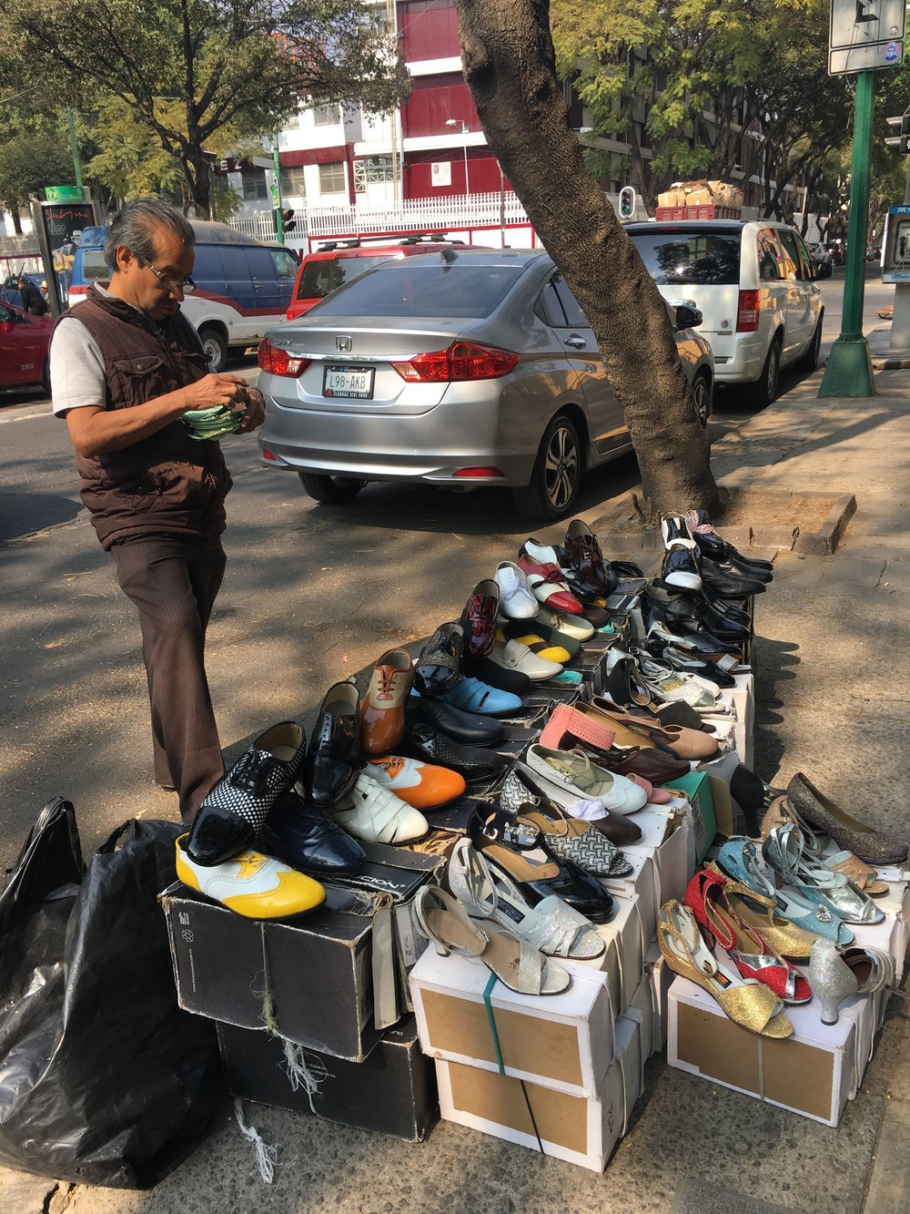 A second hand shoe seller in Mexico City.