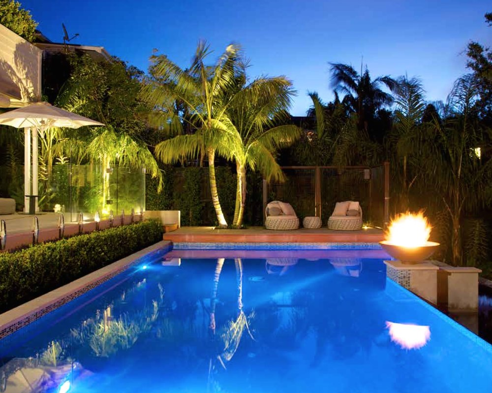 Resort style design requires softening with planting.  In this example planting at the base of the terrace and pool fence softens and frames the pool and house interface.