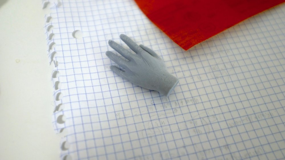 Partially sanded, larger 3-D printed hand.