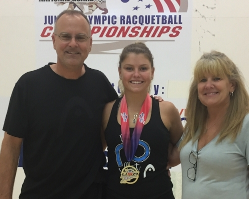 Cooperrider with her parents.