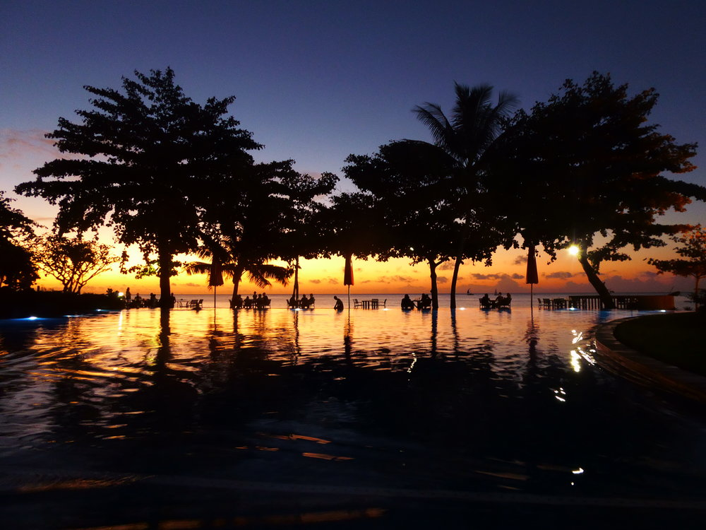 Sunset by the pool in Tahiti