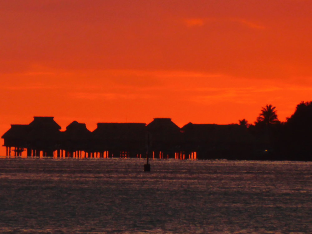 Sunset view of overwater bungalows from the viewpoint on Private Island