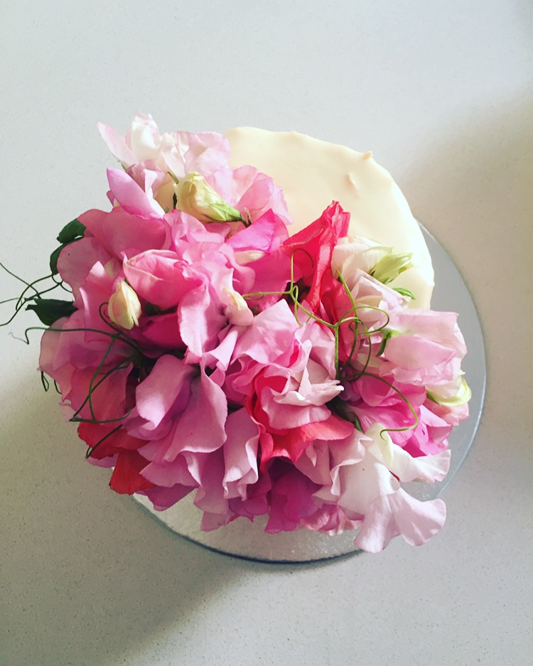 Dark chocolate cake with a sweet pea flower cascade