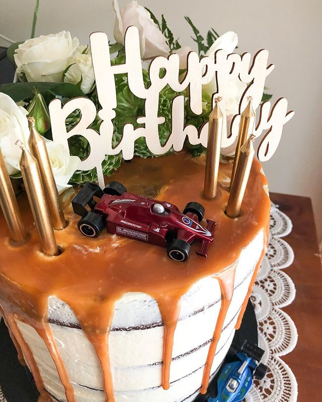 When you make a joint birthday cake for your nana and grandad...flowers and race cars 🏎 💐 . . . . . . #melbournebaker #freelancebaker #melbournecakes #thesweethall #cakesofmelbourne #birthdaycake #nana #grandad #grandadturned80 #happybirthday