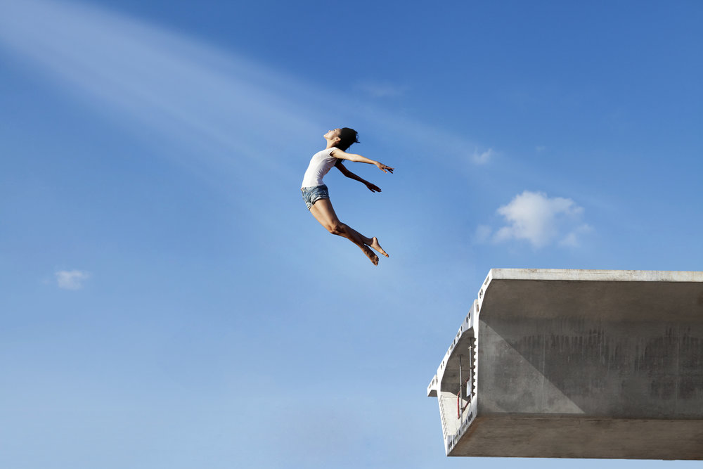Woman jumping off the bridge