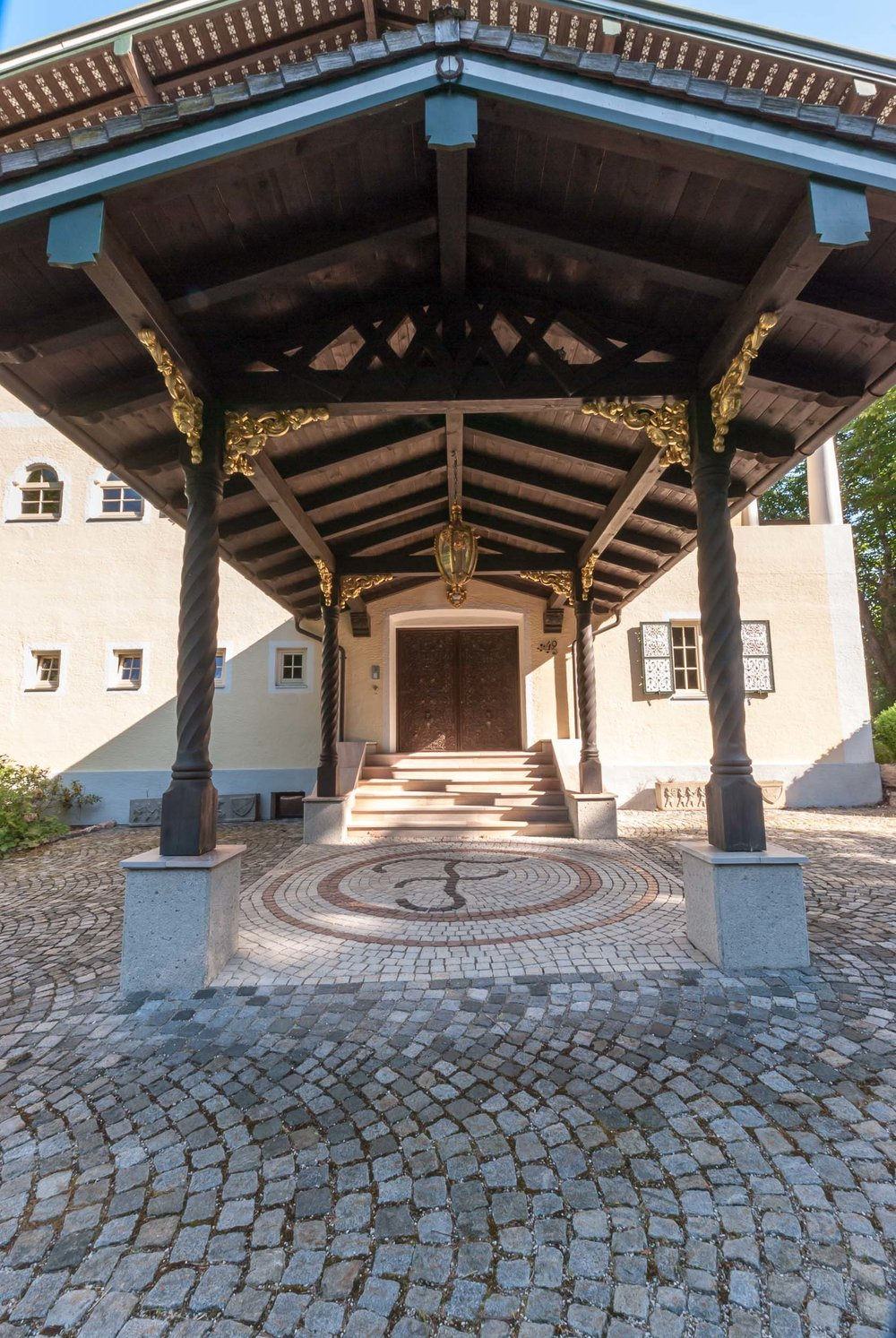 A Porte Cochère Decorated With Traditional Bavarian Carvings Ensures That  Visitors Are Protected From The .