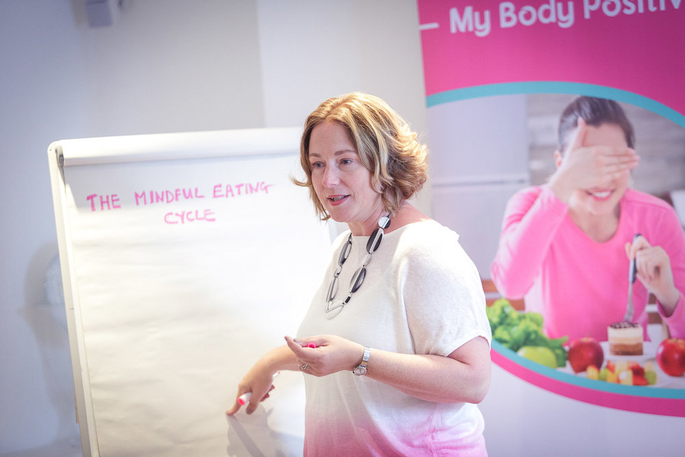 Lisa with flip board during mindful eating workshop in bristol