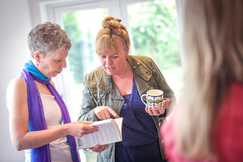 Two women chatting at mindful eating workshop for positive body image confidence in Bristol