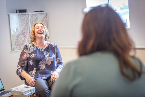 Copy of Lisa laughing during mindful eating workshop in Bristol helping women to ditch the diet with positive body image