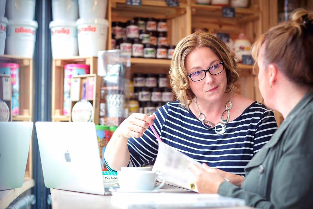 Photo of Lisa and client in Bristol Coffee Shop during positive body image coaching session