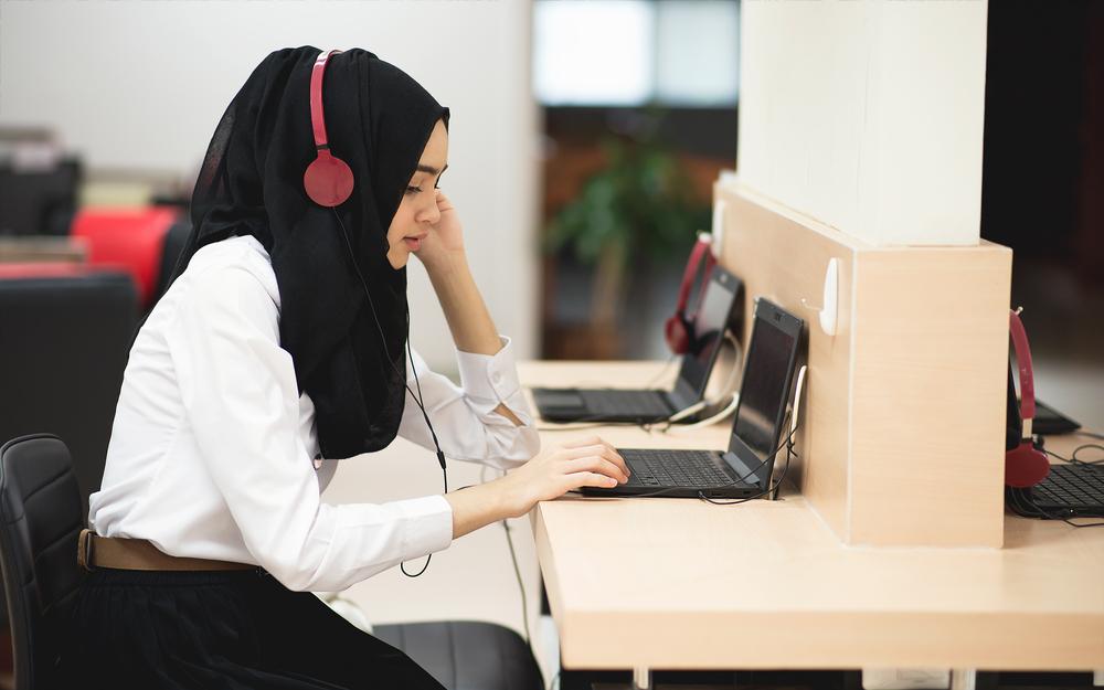 Woman with headphones headscarf.jpg