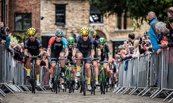 The steep climb is finished on the cobbles of Lincoln's historic streets.