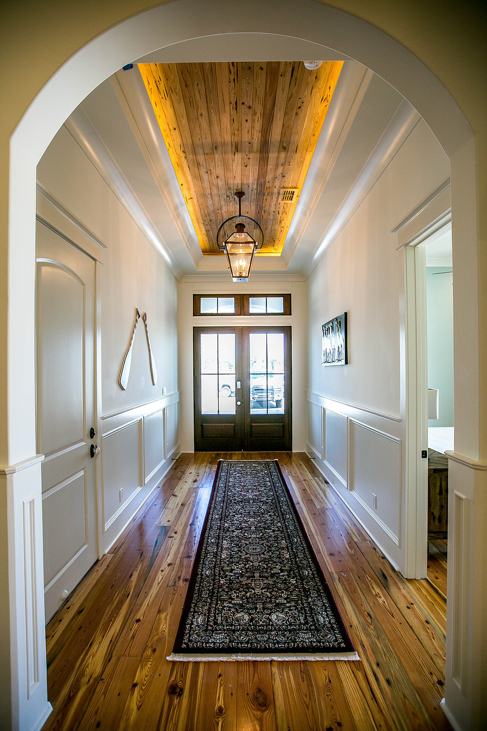 Custom Home with Wood Floors and Wood planked ceiling inset