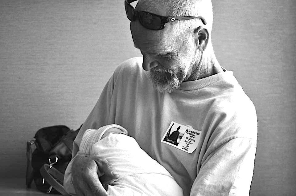 New Grandad - Rich Mitchell with baby Maddie