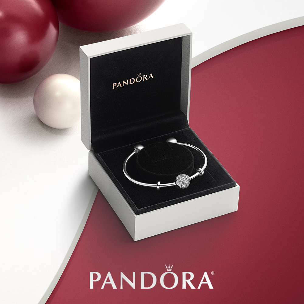 "Open bangle gift set   comes with the pave sphere charm and the ""Pandora signature ends"" in a Pandora gift box (as shown)     $ 140"