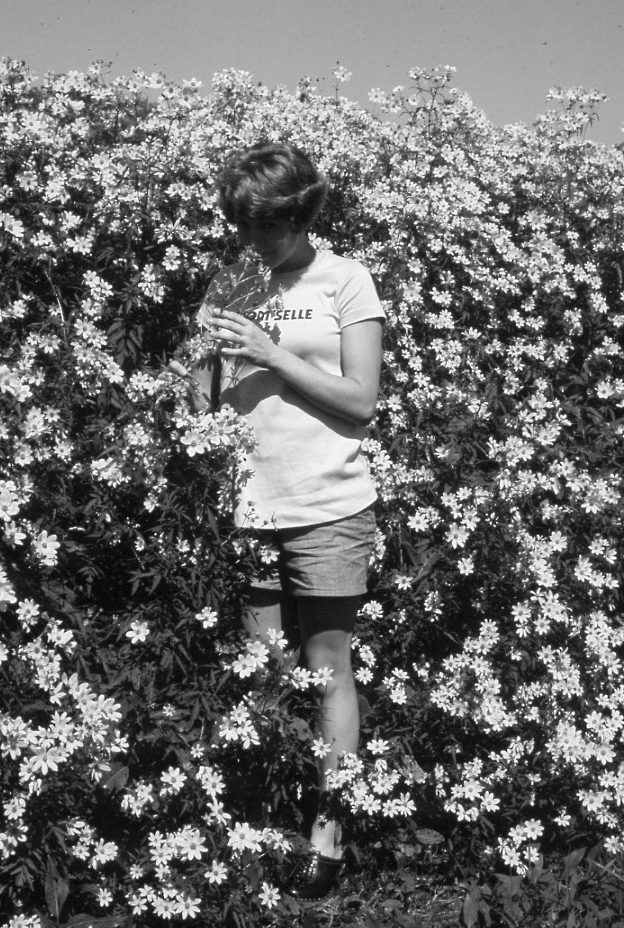 Anne with wildflowers, photo by Oscar Ellis, date unknown
