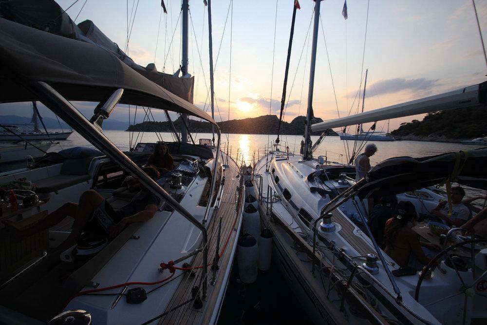 Sail boats sun setting