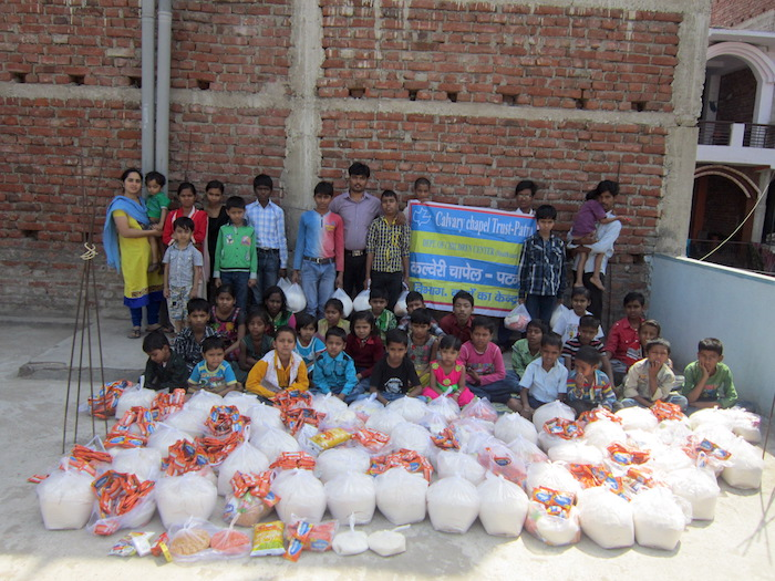 Pictures of nutrition kits and kids receiving them.