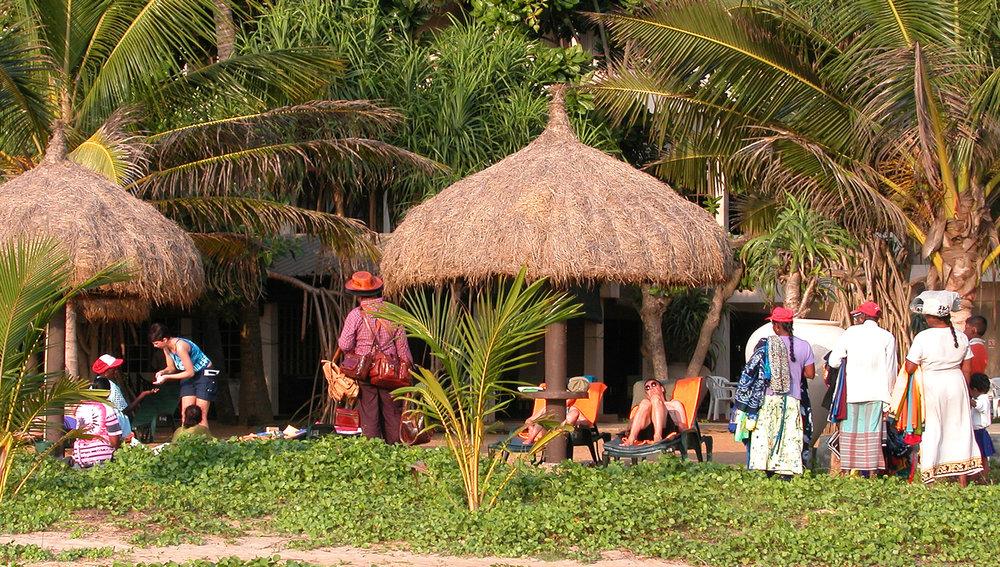 Hawkers outnumber tourists on Ethukala Beach, Sri Lanka. Image:    © David Astley