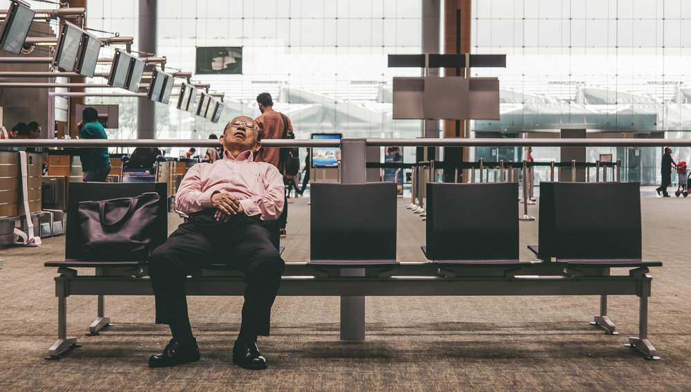Secure hand baggage before taking an airport nap.   Image:   Jay Wen