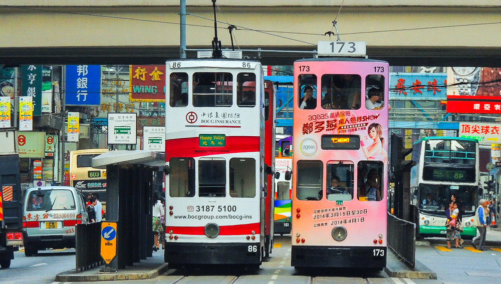 Trams on one of Hong Kong's busy streets. Image:   Andy Leung