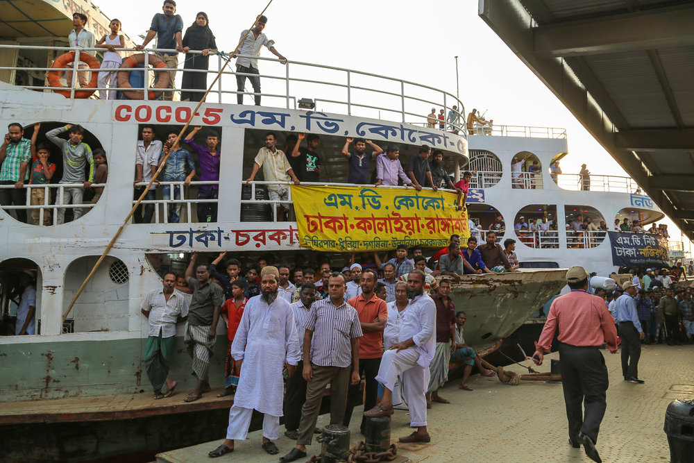 Passengers at the busy Sadarghat terminal.  Image:    ©   Alan Williams