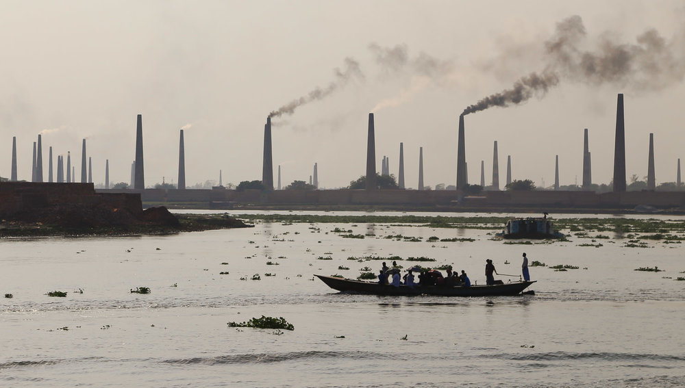 Brick factories spewing smoke along the Buriganga.  Image:  © Alan Williams