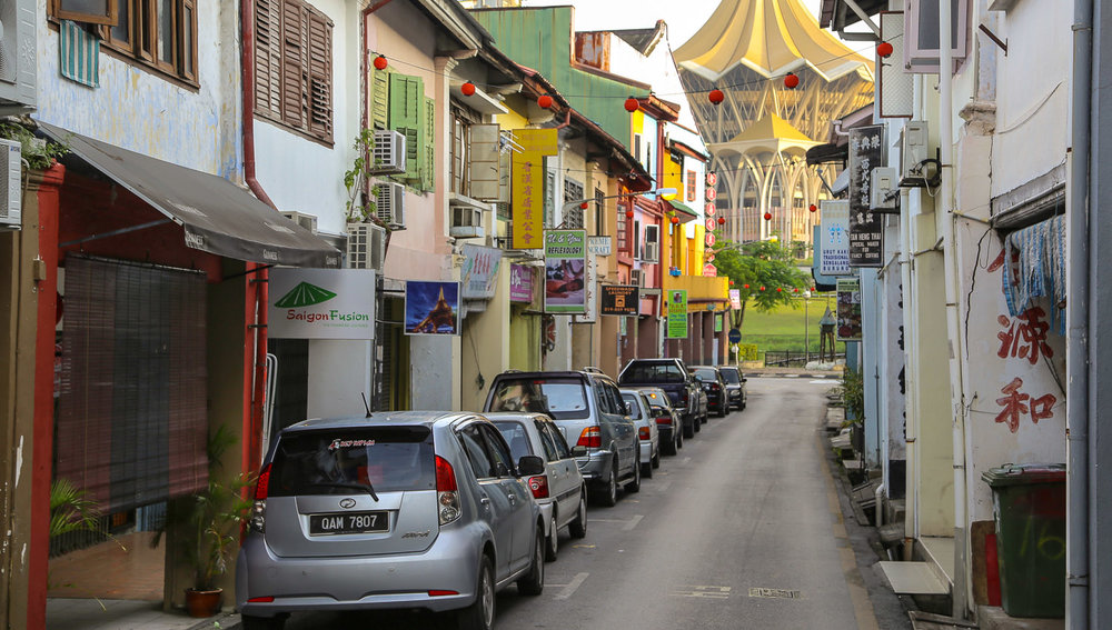 A narrow street in Kuching old town.   Image:  © Alan Williams