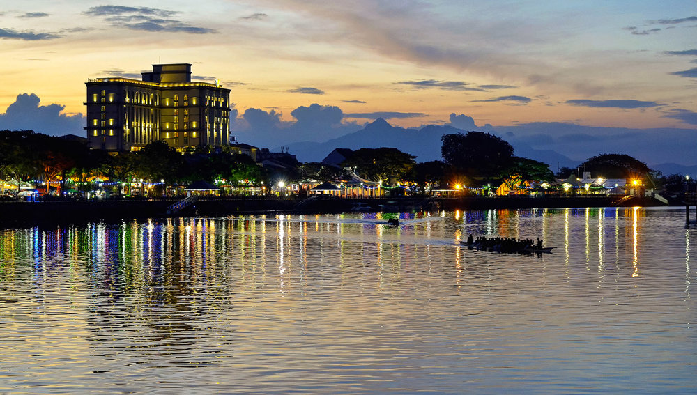 The Kuching waterfront after sunset.   Image:   morariu