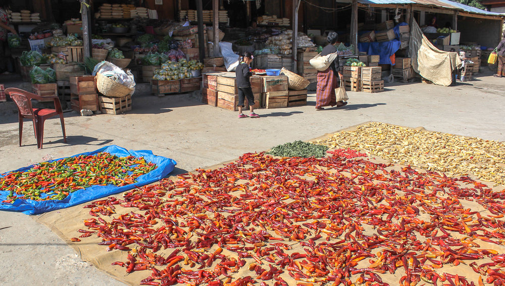 Chillies drying in a central Bhutan market. Image:  © Alan Williams