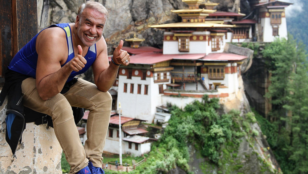 A hiker celebrates his climb to the Tiger's Nest. Image:     dannytkhan