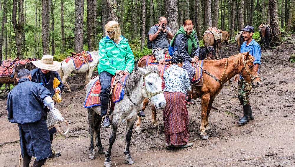 Boomers on horseback in      Bhutan     . Image:     Ipek Morel Diplikaya    | Dreamstime