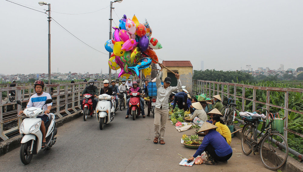 Vendors on the Long Bien Bridge. Image:  © Alan Williams
