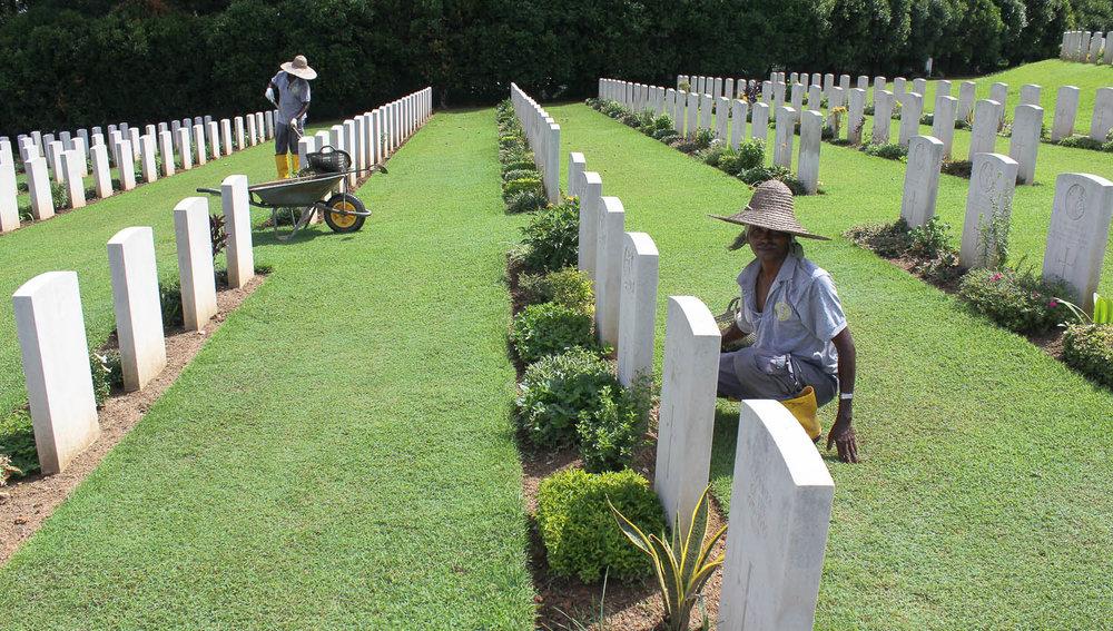 Maintaining the graves at Kranji War Cemetery. Image:  © Alan Williams