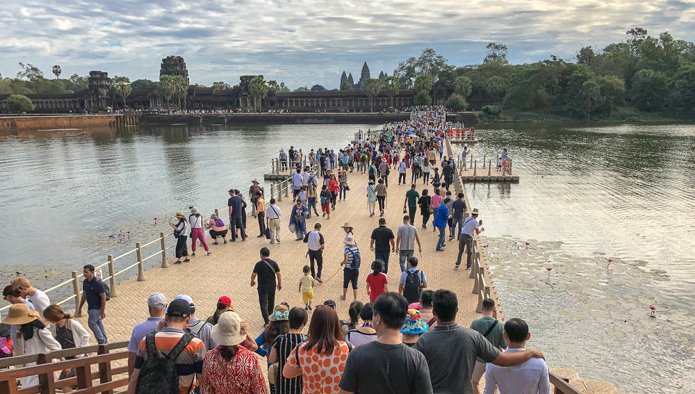 Crowds of tourists entering Angkor Wat. Image:  © Alan Williams